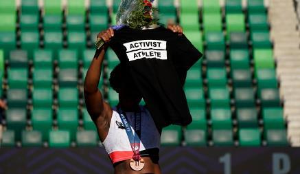 "Gwen Berry displayed an ""Activist Athlete"" black t-shirt"