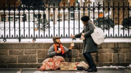 A lady is helping a poor by give her some food