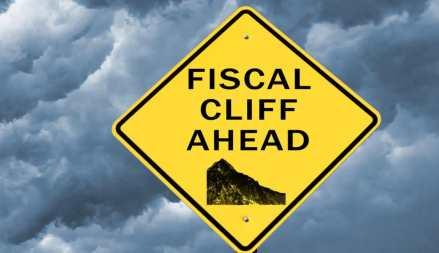 "a signboard where written ""FISCAL CLIFF AHEAD"""