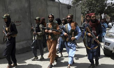 Taliban fighters holding guns