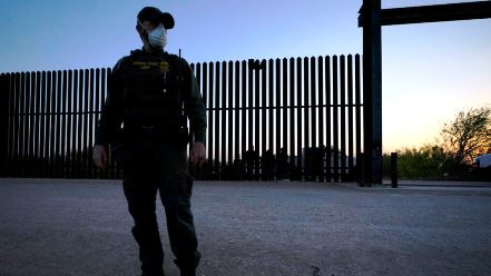 border fence and a guard