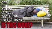 A black poor man is sleeping on the bench