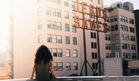 "A roadside banner where written ""JESUS SAVES"""