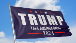 """Blue flag are proclaiming """"TRUMP TAKE AMERICAN BACK 2024"""""""