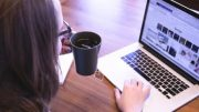 A girl is having coffee and surfing on internet