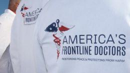 """written in T-shirt """"AMERICAN'S frontline doctors"""""""